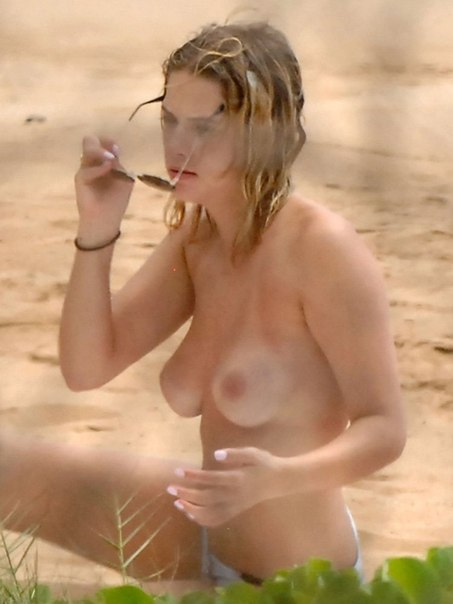 Ashley Benson - Topless at the beach in Hawaii