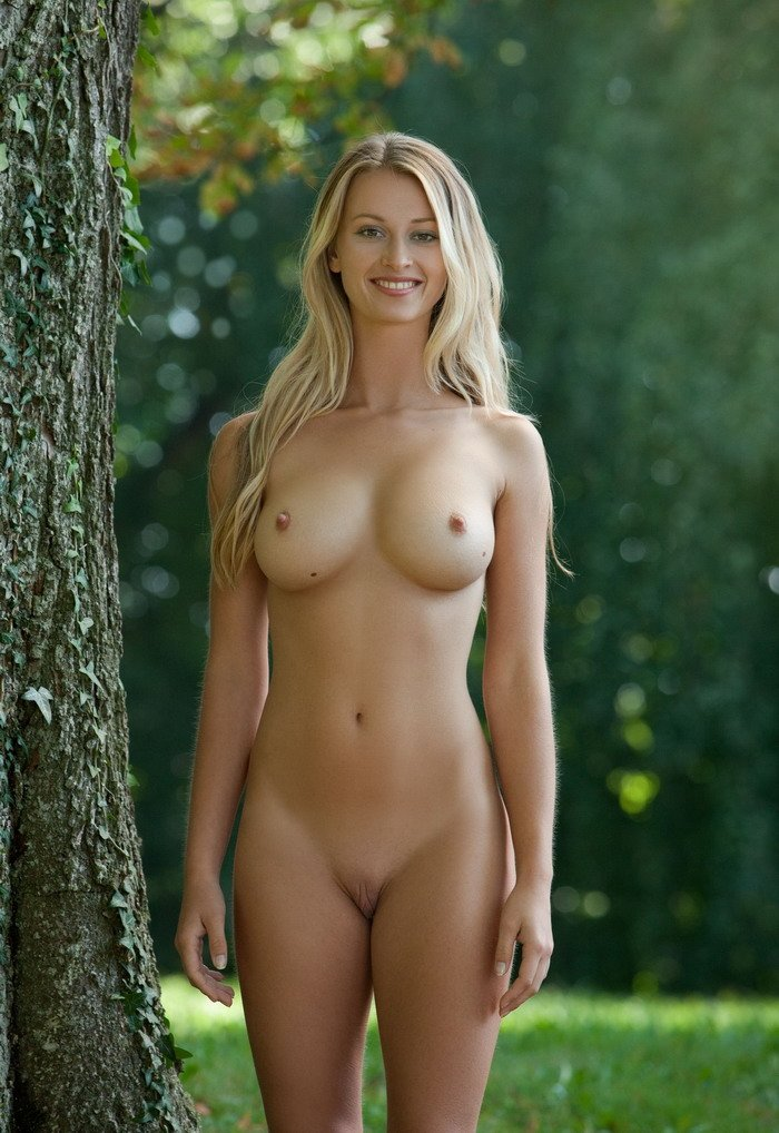 Beautiful young naked blonde woman sitting stock photo