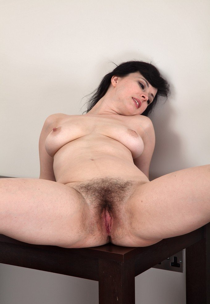 Sexy teacher shows off hairy pussy